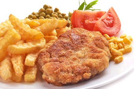 Wiener schnitzel with potato fries, isolated on white background. 版權商用圖片