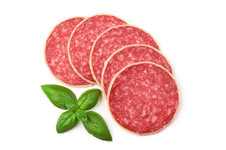 Salami with basil leaf. Smoked sausage thinly sliced, isolated on white background. Top view.