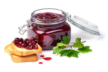Gooseberry jam with fresh berries and crispy toasters, isolated on white background.