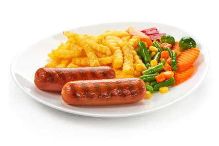 Grilled sausages with potatoes fries and vegetables, isolated on white background