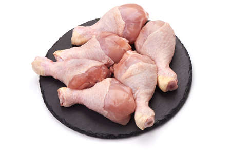 Raw chicken legs, isolated on white background. Stockfoto