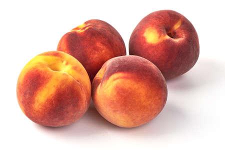 Fresh ripe juicy peaches, isolated on white background