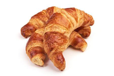 Freshly baked croissants, isolated on white background 写真素材 - 141874850