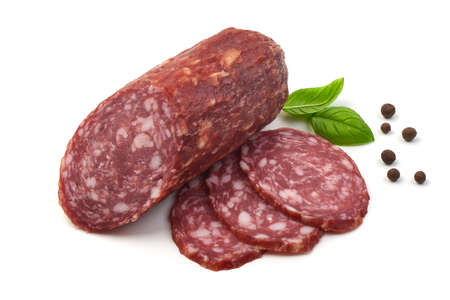 Salami smoked sausage, basil leaves and peppercorns, isolated on white background