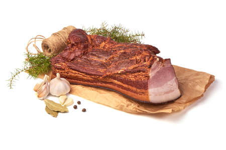Rustic Smoked Meat on a bakery paper with spices, isolated on white background Imagens