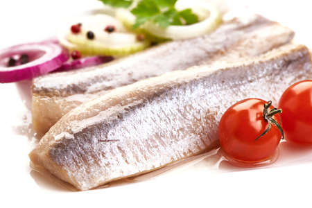 Delicious Atlantic salted herring with onion and tomatoes. Rustic style 版權商用圖片