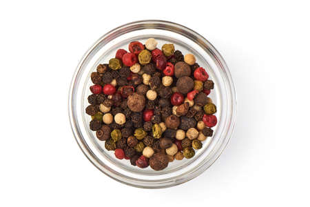 Pepper mix. Black, red and white peppercorns in a transparent cup, isolated on white background. Top view. Close-up.