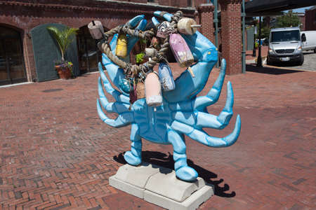 md: Baltimore, MD, USA - July 26, 2011: A large blue crab sculpture on display at Fells Point in Baltimore.