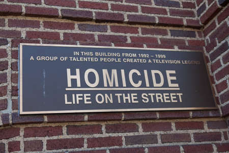 fells: Baltimore, MD, USA - July 26, 2011: A sign on the Recreation Pier at Fells Point in Baltimore commerates the building had been featured as police headquarters for NBCs  Homicide: Life on the Street.