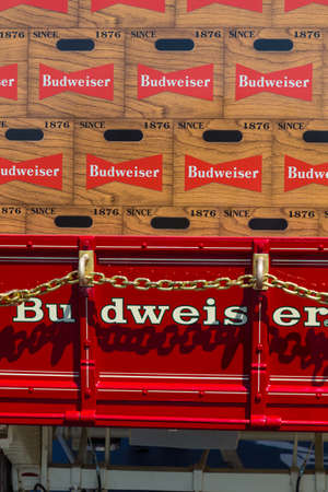 budweiser: Lancaster, PA - August 4, 2016: Close up of Budweiser Beer on red horse-drawn wagon.