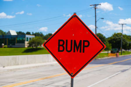bump: A bump hazard sign warning there is a bump in the roadway. Stock Photo