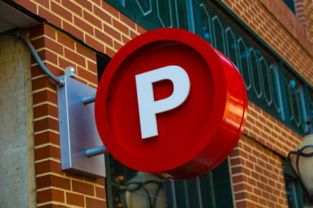 pa: Lancaster, PA - August 20, 2016: A large red circular P sign signifying a public parking garage. Stock Photo