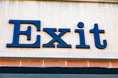 pa: Lancaster, PA - August 20, 2016: An exit sign on a public parking garage.