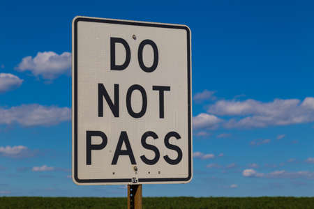 Peach Bottom, PA - August 23, 2016: A white Do Not Pass sign on a highway. Stock Photo