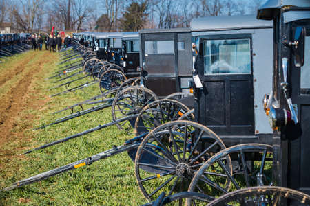 Gordonville, PA, USA - March 10, 2018: Buggies in a muddy field ready to be sold at the annual Lancaster County Mud Sale at the Gordonville Fire Company.