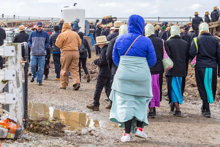 Bart, PA, USA - March 3, 2018: Muddy areas do not stop crowds in search of late winter bargains at the annual Mud Sale at the Bart Fire Company.