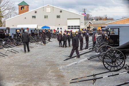 Bart, PA, USA - March 3, 2018: The annual Mud Sale at the Bart Fire Company includes Amish buggies sold at auction.