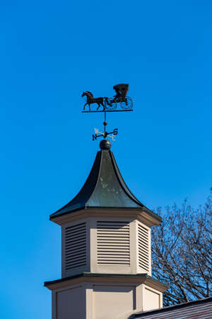 An unusual weather vane features an Amish Buggy.