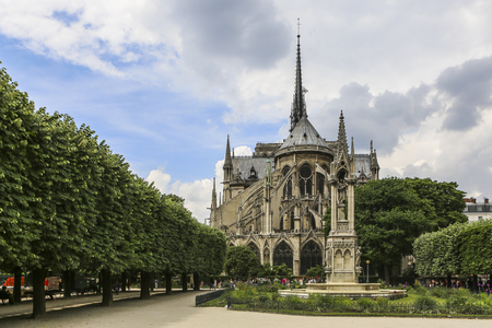 Beautiful view on Notre Dame of Paris, France, from statue in the garden