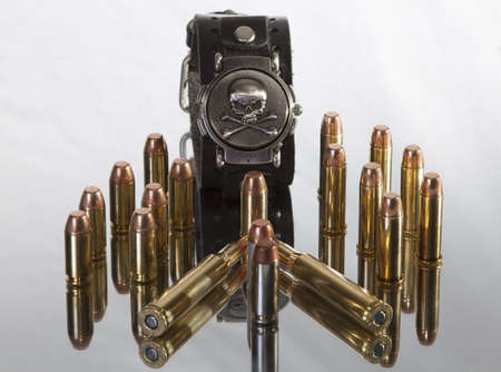 armaments: bullets and skull and crossbones Stock Photo