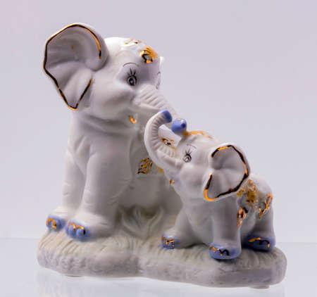 animal figurines: Figurine of Two Elephant on white Background