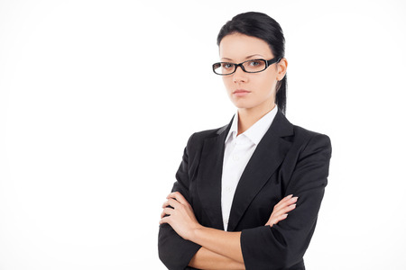 arms crossed: Confident businesswoman. Confident young business woman looking at camera and keeping her arms crossed while standing isolated on white
