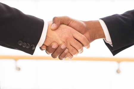 Sealing a deal. Close-up of business men shaking hands photo