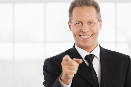 I choose you! Portrait of cheerful mature man in formalwear pointing you and smiling photo