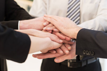 peoples: We are team. Close-up of many business people?s hands clasped together