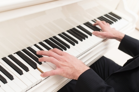 Playing piano. Close-up top view of man playing piano Stock Photo - 25058213