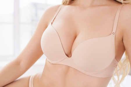 adult breast: Natural and beautiful. Close-up of perfect female breasts in bra Stock Photo