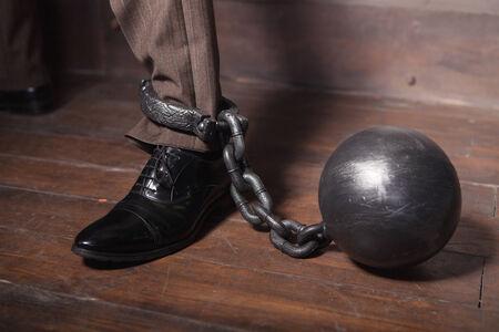 businessman leg with metal shackles photo