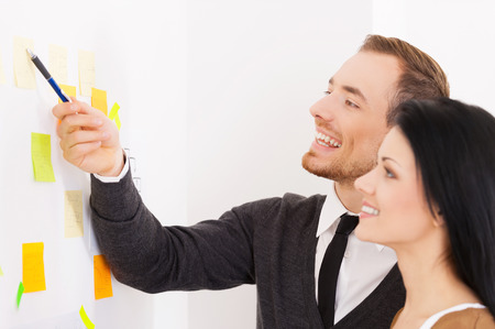 two people only: Business reminder. Business people making notes on adhesive paper Stock Photo
