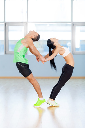 affectionate actions: Fitness couple forming a heart shape with their bodies