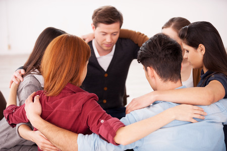Circle of trust. Group of people sitting in circle and supporting each other  photo