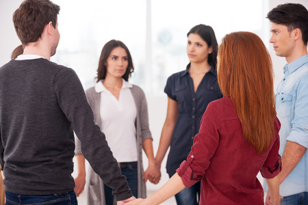 trust people: Trust circle. Group of people standing in circle and holding hands  Stock Photo