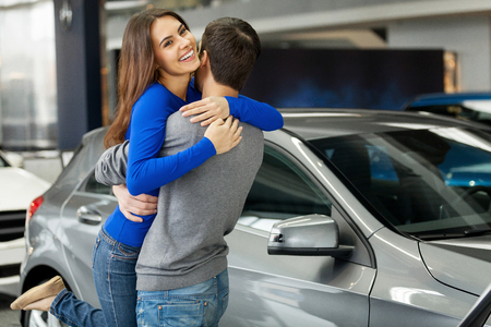 Thank you dear! Young beautiful woman hugging her boyfriend thanks for the new car