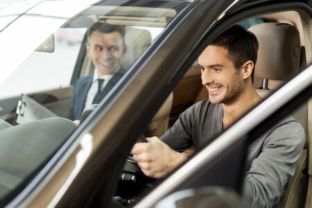 test drive: First test drive. Handsome young man ready to make first test drive