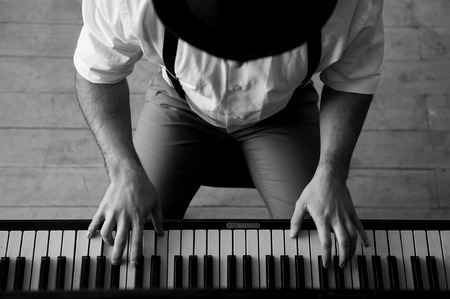 jazz: Talent and virtuosity. Black and white top view image of man playing piano Stock Photo