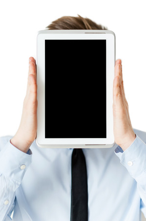 hiding face: Tablet head. Man in shirt and tie hiding his face behind digital tablet while standing isolated on white Stock Photo