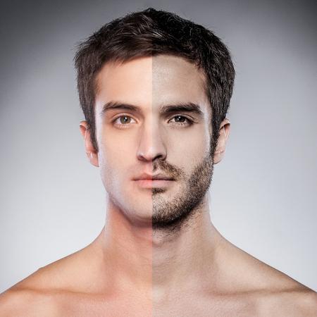 young sex: Красивый молодой человек с половиной бритой лице, глядя на камеру, стоя на сером фоне