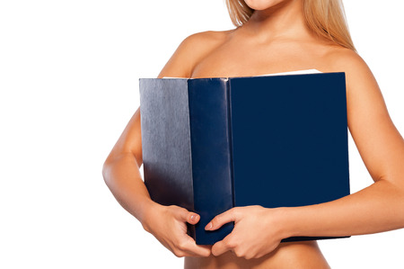 Beauty with book. Beautiful young naked woman covering breasts with book while standing isolated on white photo