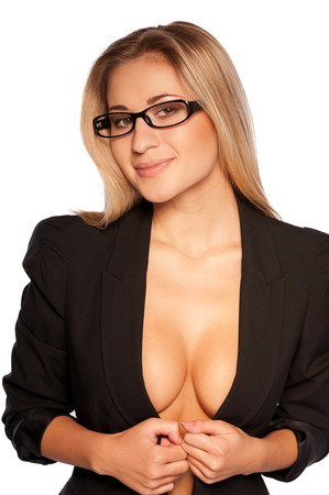 Sexy secretary. Attractive young blond hair woman with beautiful cleavage taking off her jacket and smiling while standing isolated on white  photo