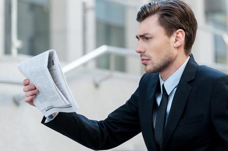 fresh news: Fresh news. Young businessman reading the newspaper