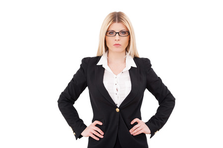 hands on hip: Confident and successful businesswoman. Confident mature businesswoman holding hands on hip and looking at camera while standing isolated on white Stock Photo