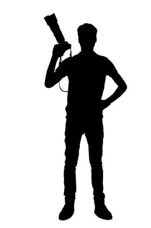 Silhouette of photographer. Full length silhouette of man holding digital camera while standing isolated on white photo