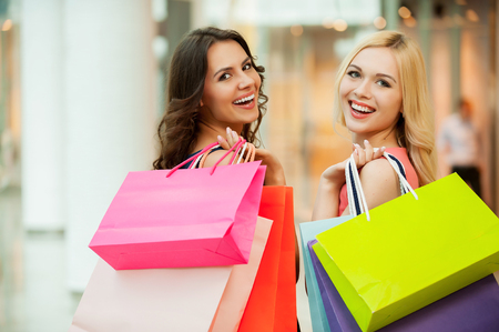 shoulder bag: Happy friends shopping. Two beautiful young women enjoying shopping at shopping mall