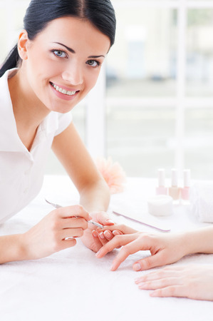 She is manicure expert. Close-up of manicure master at work