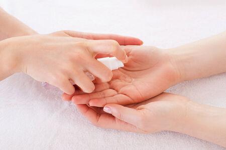 antiseptic: Applying antiseptic. Close-up of manicure master spraying antiseptic on female palm Stock Photo