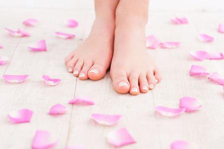handcarves: Beautiful feet. Cropped image of beautiful female feet on hardwood floor